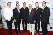 (L-R) Spirit Music Group Chairman David Renzer, Universal Music Publishing Group North America President Evan Lamberg, songwriter Dr. Luke, producer Clive Davis, composer Brian Tyler, and music executive Doug Davis arrive at City of Hope's 10th Anniversary 'Songs Of Hope' on June 4, 2014 in Brentwood, California.