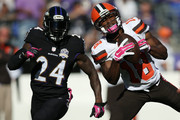 Wide receiver Travis Benjamin #11 of the Cleveland Browns catches the ball while defensive back Kyle Arrington #24 of the Baltimore Ravens defends in the fourth quarter of a game at M&T Bank Stadium on October 11, 2015 in Baltimore, Maryland.