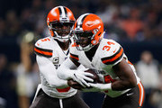 Tyrod Taylor #5 of the Cleveland Browns hands off  the ball to Carlos Hyde #34 of the Cleveland Browns during the first quarter against the New Orleans Saints  at Mercedes-Benz Superdome on September 16, 2018 in New Orleans, Louisiana.