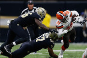 Duke Johnson #29 of the Cleveland Browns is tackled by Alex Okafor #57 of the New Orleans Saints during the first quarter  at Mercedes-Benz Superdome on September 16, 2018 in New Orleans, Louisiana.