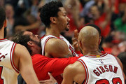 (L-R) Joakim Noah #13, Derrick Rose #1 and Taj Gibson #22 of the Chicago Bulls celebrate Rose's game-wiinning shot against the Cleveland Cavaliers in Game Three of the Eastern Conference Semifinals of the 2015 NBA Playoffs at the United Center on May 8, 2015 in Chicago, Illinois. The Bulls defeated the Cavaliers 99-96. NOTE TO USER: User expressly acknowledges and agress that, by downloading and or using the photograph, User is consenting to the terms and conditions of the Getty Images License Agreement.