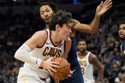 Cedi Osman #16 of the Cleveland Cavaliers drives to the basket against Derrick Rose #25 of the Minnesota Timberwolves during the second quarter of the game on October 19, 2018 at the Target Center in Minneapolis, Minnesota. NOTE TO USER: User expressly acknowledges and agrees that, by downloading and or using this Photograph, user is consenting to the terms and conditions of the Getty Images License Agreement.