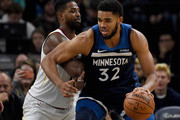 Tristan Thompson #13 of the Cleveland Cavaliers defends against Karl-Anthony Towns #32 of the Minnesota Timberwolves during the second quarter of the game on October 19, 2018 at the Target Center in Minneapolis, Minnesota. NOTE TO USER: User expressly acknowledges and agrees that, by downloading and or using this Photograph, user is consenting to the terms and conditions of the Getty Images License Agreement.