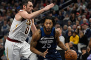 Derrick Rose #25 of the Minnesota Timberwolves drives to the basket against Kevin Love #0 of the Cleveland Cavaliers during the third quarter of the game on October 19, 2018 at the Target Center in Minneapolis, Minnesota. The Timberwolves defeated the Cavaliers 131-123. NOTE TO USER: User expressly acknowledges and agrees that, by downloading and or using this Photograph, user is consenting to the terms and conditions of the Getty Images License Agreement.