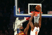 Kyle O'Quinn #9 of the New York Knicks goes up for a dunk against LeBron James #23 of the Cleveland Cavaliers in the first half at Madison Square Garden on April 9, 2018 in New York City. NOTE TO USER: User expressly acknowledges and agrees that, by downloading and or using this photograph, User is consenting to the terms and conditions of the Getty Images License Agreement.