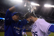 Salvador Perez #13 of the Kansas City Royals pours water over the head of Eric Hosmer #35 as they celebrate a 4-2 win over the Cleveland Indians at Kauffman Stadium on June 3, 2015 in Kansas City, Missouri.