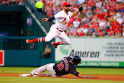 Edwin Encarnacion #10 of the Cleveland Indians breaks up a double play attempt against Greg Garcia #35 of the St. Louis Cardinals in the third inning at Busch Stadium on June 27, 2018 in St. Louis, Missouri.