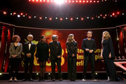 (L-R) Jury Members Stephanie Zacharek, Ryuichi Sakamoto, Adele Romanski, Chema Prado, Cecile de France, Jury President Tom Tykwer and Host Anke Engelke are seen on stage at the closing ceremony during the 68th Berlinale International Film Festival Berlin at Berlinale Palast on February 24, 2018 in Berlin, Germany.