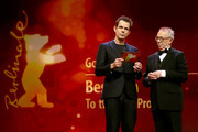 (L-R) Tom Tykwer and Dieter Kosslick are seen on stage at the closing ceremony during the 68th Berlinale International Film Festival Berlin at Berlinale Palast on February 24, 2018 in Berlin, Germany.