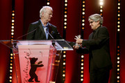 Bill Murray (L) receives the Silver Bear for Best Director for Wes Anderson for 'Isle of Dogs' from jury member Chema Prado at the closing ceremony during the 68th Berlinale International Film Festival Berlin at Berlinale Palast on February 24, 2018 in Berlin, Germany.