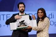 """Italian Director Noaz Deshe accepts the Lion of the future - """"Luigi de Laurentiis"""" Venice award for a debut film from Jury president Haifaa al-Mansour on stage during the Closing Ceremony at the 70th Venice International Film Festival at the Palazzo del Casino on September 7, 2013 in Venice, Italy."""