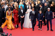 """(L-R) Jury Members Maimouna N'Diaye, Alice Rohrwacher, Pawel Pawlikowski, Elle Fanning, Alejandro Gonzalez Inarritu, Kelly Reichardt and Robin Campillo attend the closing ceremony screening of """"The Specials"""" during the 72nd annual Cannes Film Festival on May 25, 2019 in Cannes, France."""