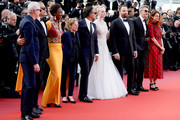 """(L-R) Jury members of the main competition Robin Campillo, Pawel Pawlikowski, Alice Rohrwacher, Enki Bilal, Elle Fanning, Yorgos Lanthimos, Alejandro Gonzalez Inarritu, Kelly Reichardt and Maimouna N'Diaye attend the closing ceremony screening of """"The Specials"""" during the 72nd annual Cannes Film Festival on May 25, 2019 in Cannes, France."""