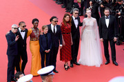 """(L-R) Jury members of the main competition Robin Campillo, Enki Bilal, Maimouna N'Diaye, Kelly Reichardt, President of the Main competition jury Alejandro Gonzalez Inarritu, Alice Rohrwacher, Pawel Pawlikowski, Elle Fanning and Yorgos Lanthimos attend the closing ceremony screening of """"The Specials"""" during the 72nd annual Cannes Film Festival on May 25, 2019 in Cannes, France."""