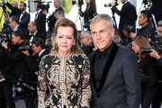 """Caroline Scheufele and Christoph Waltz attend the closing ceremony screening of """"The Specials"""" during the 72nd annual Cannes Film Festival on May 25, 2019 in Cannes, France."""