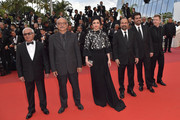 (FromL) Iranian actor Farid Sajjadihosseini, Iranian actor Babak Karimi, Iranian actress Taraneh Alidoosti, Iranian director Asghar Farhadi, Iranian actor Shahab Hosseini and French producer and distributor Alexandre Mallet-Guy pose as they arrive on May 22, 2016 for the closing ceremony of the 69th Cannes Film Festival in Cannes, southern France.  / AFP / LOIC VENANCE