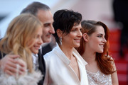(L-R) Actresses Chloe Grace Moretz, director Olivier Assayas, Juliette Binoche and Kristen Stewart attend the 'Clouds Of Sils Maria' premiere during the 67th Annual Cannes Film Festival on May 23, 2014 in Cannes, France.