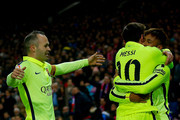 Neymar JR. of FC Barcelona embraces his teammate Lionel Messi (2ndL) celebrating scoring their third goal as Andres Iniesta (L) approaches them during the Copa del Rey Round of 8 second leg match between Club Atletico de Madrid and FC Barcelona at Vicente Calderon Stadium on January 28, 2015 in Madrid, Spain.