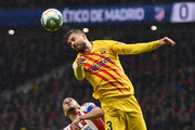 Gerard Pique of FC Barcelona outjumps Koke of Atletico Madrid during the Liga match between Club Atletico de Madrid and FC Barcelona at Wanda Metropolitano on December 01, 2019 in Madrid, Spain.