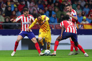 Lionel Messi of FC Barcelona takes on Saul Niguez, Thomas Partey and Koke of Atletico Madrid during the Liga match between Club Atletico de Madrid and FC Barcelona at Wanda Metropolitano on December 01, 2019 in Madrid, Spain.