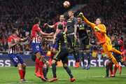 Diego Godin of Atletico Madrid and Mario Mandzukic of Juventus compete for a header during the UEFA Champions League Round of 16 First Leg match between Club Atletico de Madrid and Juventus at Estadio Wanda Metropolitano on February 20, 2019 in Madrid, Spain.