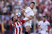 Yannick Carrasco (L) of Atletico de Madrid competes for the ball with Samir Nasri (R) of Sevilla FC during the La Liga match between Club Atletico de Madrid and Sevilla FC at Vicente Calderon stadium on March 19, 2017 in Madrid, Spain.