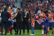 Diego Godin of Atletico Madrid chats with Diego Simeone, manager of Atletico Madrid after Godin's last home match for the club at the end of the La Liga match between  Club Atletico de Madrid and Sevilla FC at Wanda Metropolitano on May 12, 2019 in Madrid, Spain.