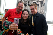 (L-R) Sophie Bein (C), Uwe Bein (L) and Philipp Lahm (R) do a selfie during the Club Of Former National Players Meeting at BayArena on June 8, 2018 in Leverkusen, Germany.
