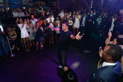 Former NBA player and head coach for Cal State Northridge Reggie Theus dances after being introduced as one of the celebrity golfers in the Coach Woodson Las Vegas Invitational at the red carpet and pairings party at 1 OAK Nightclub at The Mirage Hotel & Casino on July 10, 2016 in Las Vegas, Nevada.