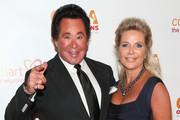 Singer Wayne Newton (L) and his wife, Kathleen McCrone, attend CoachArt's 9th Annual Gala of Champions at The Beverly Hilton Hotel on October 17, 2013 in Beverly Hills, California.