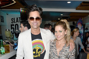 (L-R) John Stamos and Candace Cameron-Bure attend Cold Stone Creamery Backstage at 2019 Teen Choice Awards on August 11, 2019 in Hermosa Beach, California.