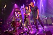(L-R) Musicians Jonny Buckland, Will Champion, Guy Berryman and Chris Martin of Coldplay perform onstage during their iHeartRadio Album Release Party at the iHeartRadio Theater Los Angeles on May 16, 2014 in Burbank, California. Streaming Live on Yahoo Screen and Clear Channel stations across the country.