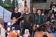 "(L-R) guitarist Jonny Buckland, drummer Will Champion, singer Chris Martin and bassist Guy Berryman of Coldplay perform on NBC's ""Today"" at Rockefeller Plaza on March 14, 2016 in New York City."