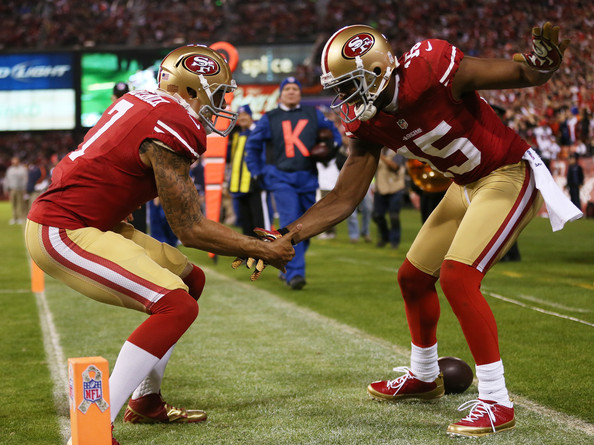 Colin Kaepernick celbrates his touchdown pass to Michae Crabtree