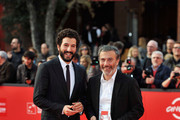 Francesco Scianna and Paolo Sassanelli poses with the L.A.R.A. Award for Best Italian Actor as he attends the Collateral Awards Red Carpet photocall during the 7th Rome Film Festival at Auditorium Parco Della Musica on November 17, 2012 in Rome, Italy.