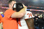 John Simpson #74 of the Clemson Tigers celebrates his teams 29-23 win over the Ohio State Buckeyes in the College Football Playoff Semifinal at the PlayStation Fiesta Bowl at State Farm Stadium on December 28, 2019 in Glendale, Arizona.