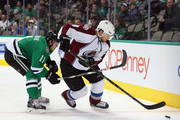 Jan Hejda #8 of the Colorado Avalanche skates the puck against Curtis McKenzie #11 of the Dallas Stars in the first period at American Airlines Center on February 27, 2015 in Dallas, Texas.
