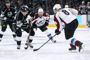 Trevor Lewis #22 of the Los Angeles Kings skates with the puck against Jan Hejda #8 of the Colorado Avalanche at Staples Center on April 4, 2015 in Los Angeles, California.