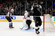 Semyon Varlamov #1 and Nathan MacKinnon #29 of the Colorado Avalanche look on after Dustin Brown #23 of the Los Angeles Kings scores the winning goal in overtime during a game at Staples Center on December 21, 2017 in Los Angeles, California.  Brown was playing in his one thousandth NHL game.