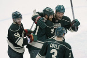 (L-R) Erik Haula #56, Kyle Brodziak #21, Cody McCormick #8 and Charlie Coyle #3 of the Minnesota Wild celebrate a win against the Colorado Avalanche after Game Six of the First Round of the 2014 NHL Stanley Cup Playoffs on April 28, 2014 at Xcel Energy Center in St Paul, Minnesota. The Wild defeated the Avalanche 5-2.