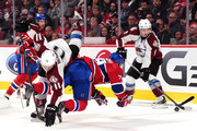 Jamie McGinn #11 of the Colorado Avalanche and Andrei Markov #79 of the Montreal Canadiens collide during the NHL game at the Bell Centre on October 18, 2014 in Montreal, Quebec, Canada.