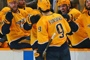 Mattias Ekholm #14 and Mike Fisher #12 celebrate with teammate Filip Forsberg #9 of the Nashville Predators Forsberg's second goal of the game against the Colorado Avalanche during the third period of a 5-2 Predators victory in Game One of the Western Conference First Round during the 2018 NHL Stanley Cup Playoffs at Bridgestone Arena on April 12, 2018 in Nashville, Tennessee.