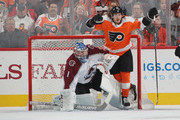 Travis Konecny #11 of the Philadelphia Flyers moves out of the crease as Semyon Varlamov #1 of the Colorado Avalanche keeps his eyes on the puck during the first period  at the Wells Fargo Center on October 22, 2018 in Philadelphia, Pennsylvania.