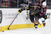 Sergei Boikov #42 of the Colorado Avalanche hits Max Pacioretty #67 of the Vegas Golden Knights as they battle for the puck in the second period of their preseason game at T-Mobile Arena on September 24, 2018 in Las Vegas, Nevada.
