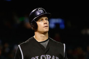 Justin Morneau #33 of the Colorado Rockies reacts after striking out against the Arizona Diamondbacks during the sixth inning of the MLB game at Chase Field on September 30, 2015 in Phoenix, Arizona.