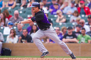 Justin Morneau #33 of the Colorado Rockies bats during a spring training game against the Arizona Diamondbacks at Salt River Fields at Talking Stick on February 28, 2014 in Scottsdale, Arizona.