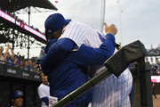 Anthony Rizzo (R) of the Chicago Cubs is greeted by Joe Maddon #70 of the Chicago Cubs after hitting a home run against the Colorado Rockies during the first inning on May 1, 2018 at Wrigley Field  in Chicago, Illinois.