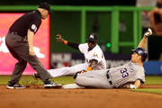 Justin Morneau #33 of the Colorado Rockies is tagged out at second base by shortstop Adeiny Hechavarria #3 of the Miami Marlins during the second inning at the Marlins Park on April 1, 2014 in Miami, Florida.
