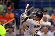 Justin Morneau #33 of the Colorado Rockies gets a base hit against the Miami Marlins during the third inning at the Marlins Park on April 1, 2014 in Miami, Florida.