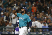 Denard Span #4 of the Seattle Mariners points to the sky as he crosses home after hitting a home run in the sixth inning against the Colorado Rockies at Safeco Field on July 6, 2018 in Seattle, Washington.